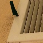 The pen holding the vent in place.