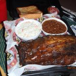 1/2 slab of ribs with coleslaw, bake beans and a piece of texas toast