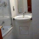 Snug bathroom with heated towel rail