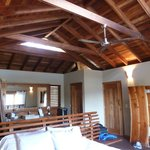 villa is one room with exposed wood ceilings