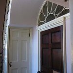 A door with a fanlight/transom above