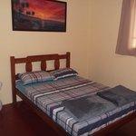 Suite casal e também quartos compartilhados no hostel