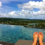Infinity Pool on the top Terrace with view of Lagoon and forest