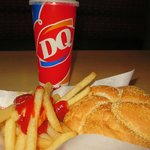 Cheeseburger Sandwich, French Fries and Soft Drink.