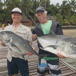Happy fishermen with their GTs.