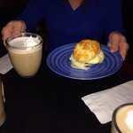 Sausage egg cheese biscuit with latte