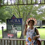 Wife in front of entrance to the Laura plantation