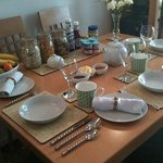 The breakfast table set for guests