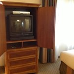 The TV in a cabinet.