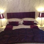 Luxury King size bed with feather and down bedding.