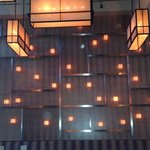 Cool lighting wall in dining room.