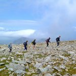 3 Peaks challenge: Walkers near the summit of Scafell Pike - Mountain Journeys