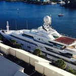 Mega yacht in front of hotel marina