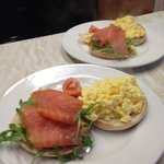 Bagel with scrambled eggs and smoked salmon.