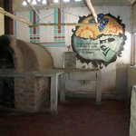 pizza oven and mural in part of the kitchen