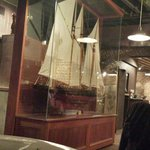 Lg glass incased boat in middle dinning room.