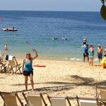 Beautful Beach with chairs, hammocks further back