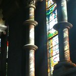 Sunrays getting in through the astonishing stained glass.