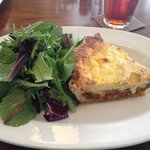 Seasonal quiche with mixed greens