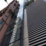 skinny modern building wedged between!