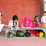 Children  learn to read the Quran
