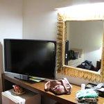 Decent TV & decor in room.