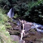 Tori at the waterfall on the property