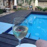 Glass of local wine by the pool