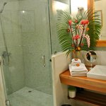 The bathroom and fresh floral arrangement