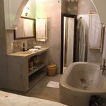Senior suite bath with wash basin and toilet with its own door. Towels are proved.