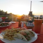 Fish taco and rum punch at sunset