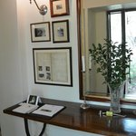 Foyer of room- lots of charming details like old photos and journal entries from past generation