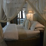 Bed with mosquito canopy tied up