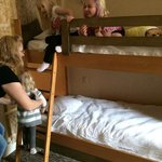 The girls playing on the bunk beds