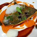 Sea Bass with tomato,bisque and light garlic foam