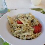 Mouthwatering penne pasta with fresh tomatoes, pesto, olive oil, cream, and toasted pine nuts. S