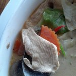 Tom Kha, close-up of tender white meat chicken