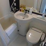 Clean bathroom with bathtub