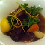 Slow cooked brisket in red wine broth and summer vegetables