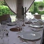 The table set for dinner on the terrace at Manoir de Gourin