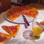 A tasty pizza prepared in front of us