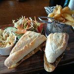 Pulled pork on ciabatta with home made coleslaw and pickle with home made chips and side salad