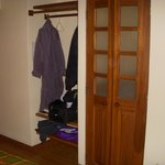open closet and bath entry, not very private, bath is sink toilet and shower, great water pressu