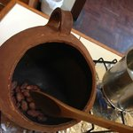 roasting the cacao beans before turning it into hot chocolate and tea