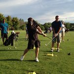 practicing at the driving range