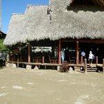entering restaurant from beach