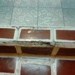 Broken/dangerous floor tiles entrance to bathroom
