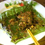 The spiced beef in banana leaf