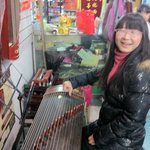 Lisa showed us the musical instruments she plays, the Guqin and Guzheng