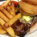 Sirloin steak, chunky chips, blue cheese butter, onion rings, tomato and mushtooms